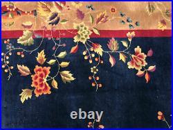 An Antique 9' x12' Blue Ground Art Deco Chinese Rug